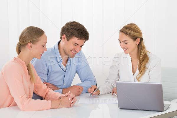 Advisor Showing Document To Couple Stock photo © AndreyPopov