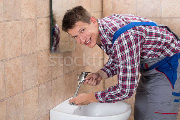 Plumber Fixing Tap Of Sink Stock photo © AndreyPopov