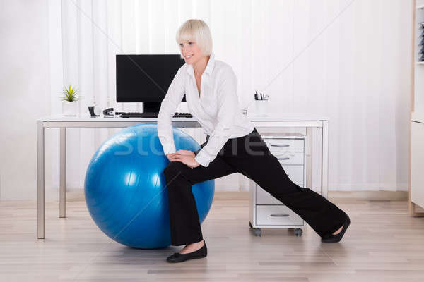 Businesswoman Stretching Her Legs Stock photo © AndreyPopov