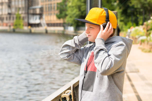 Boy Looking At Lake While Listening To Music Stock photo © AndreyPopov