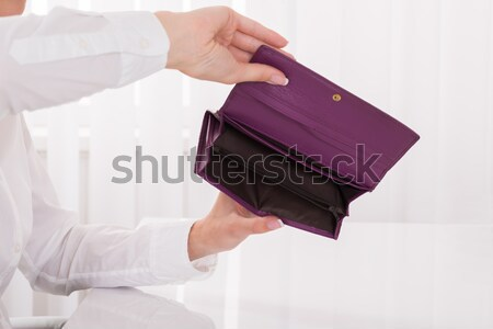 Person's Hand Holding Empty Purse Stock photo © AndreyPopov