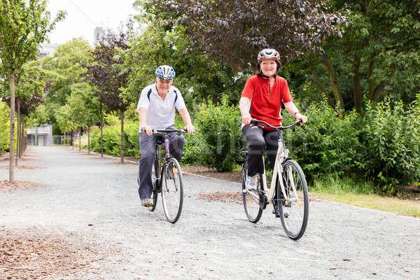 Sorridere ciclismo parco anziani mattina Foto d'archivio © AndreyPopov