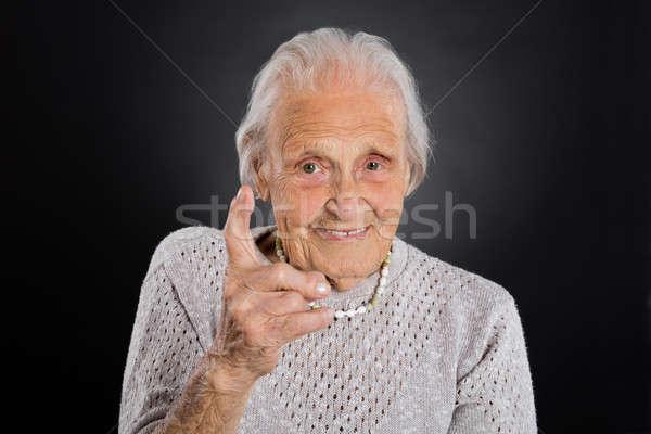 Stock photo: Smiling Elder Woman Waving Her Finger