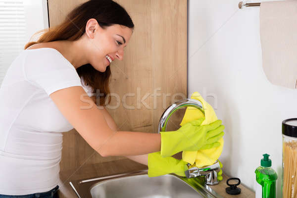 Happy Woman Cleaning The Tap Stock photo © AndreyPopov