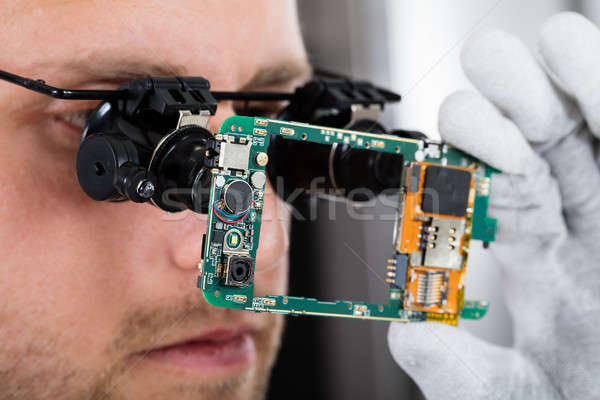Technician Fixing Damaged Mobile Phone Stock photo © AndreyPopov