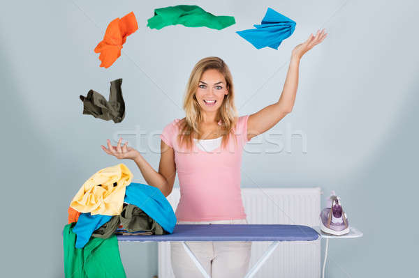 Smiling Woman With Juggling Clothes Stock photo © AndreyPopov