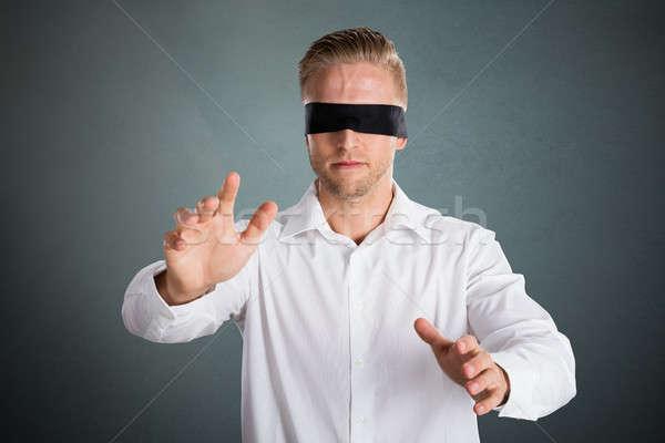 Fiatal bekötött szemű üzletember elveszett szürke arc Stock fotó © AndreyPopov