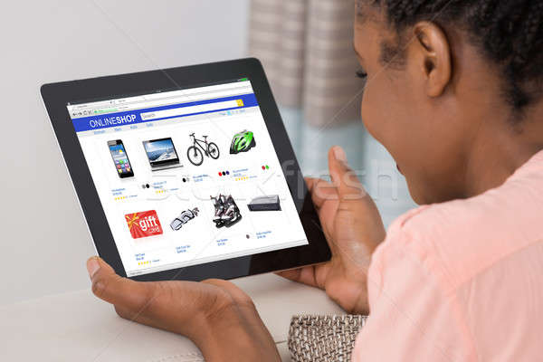 Woman Shopping Online On Digital Tablet Stock photo © AndreyPopov