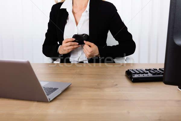 Femme d'affaires cacher souris blazer voler Photo stock © AndreyPopov