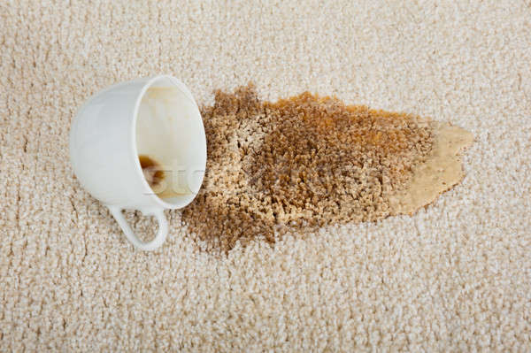Coffee Spilling From Cup On Carpet Stock photo © AndreyPopov