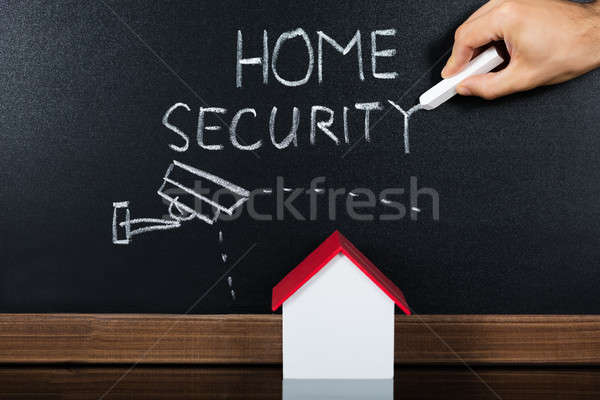 House Model With Home Security Concept On Blackboard Stock photo © AndreyPopov