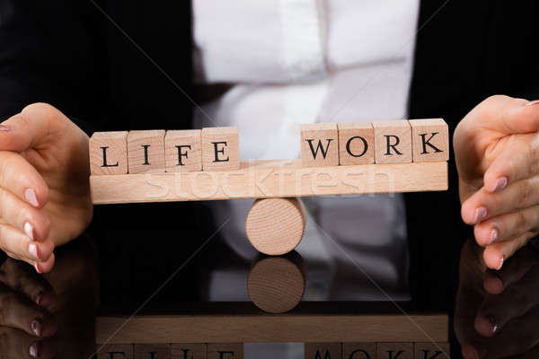 Life And Work Blocks Balancing On Seesaw Stock photo © AndreyPopov