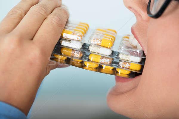 Vrouw capsules mond achtergrond Stockfoto © AndreyPopov