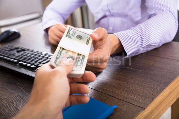 Businessman Taking Bribe In Office Stock photo © AndreyPopov