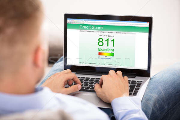 Businesswoman Checking Online Credit Score Stock photo © AndreyPopov