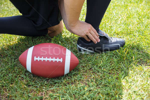 American Football Player With Pain In His Ankle On Field Stock photo © AndreyPopov
