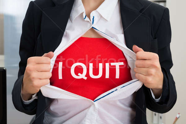 Businesswoman Tearing Off Shirt With I Quit Sign Stock photo © AndreyPopov