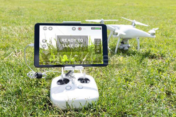 Közelkép füves mező park digitális tabletta Stock fotó © AndreyPopov