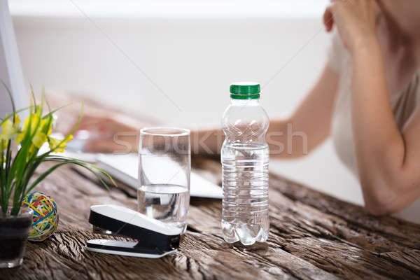 Water Bottle And Drinking Glass On Desk Stock photo © AndreyPopov
