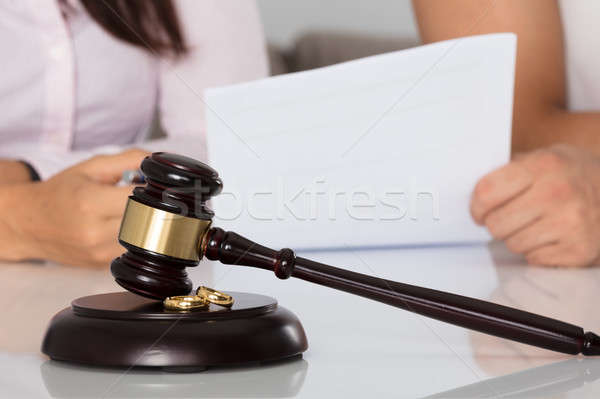 Couple Having Discussion Over Document In Courtroom Stock photo © AndreyPopov