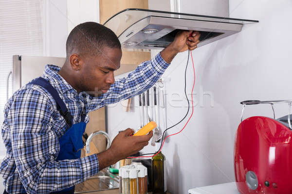 Handyman cozinha filtrar casa quarto trabalhador Foto stock © AndreyPopov