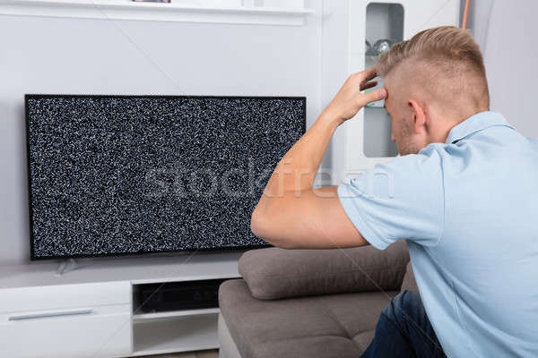 Man In Front Of Television With No Signal Stock photo © AndreyPopov