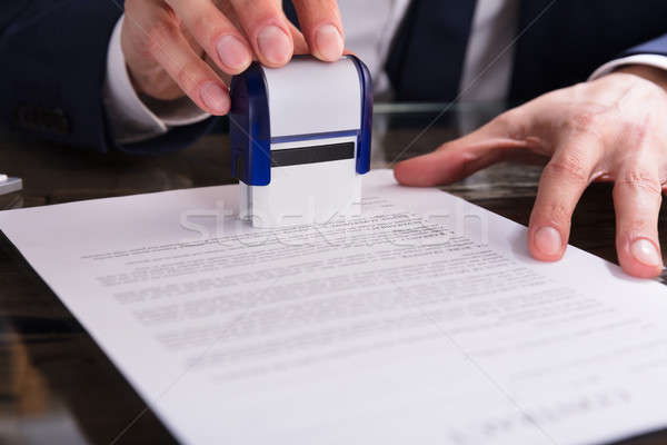 Businessperson Stamping Document In Office Stock photo © AndreyPopov