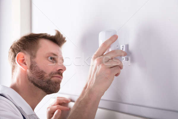 Electrician Installing Security System Door Sensor Stock photo © AndreyPopov