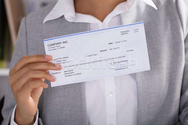 Businesswoman Showing Cheque Stock photo © AndreyPopov