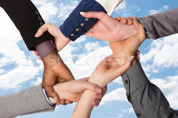 Group Of Businesspeople Holding Wrist Stock photo © AndreyPopov