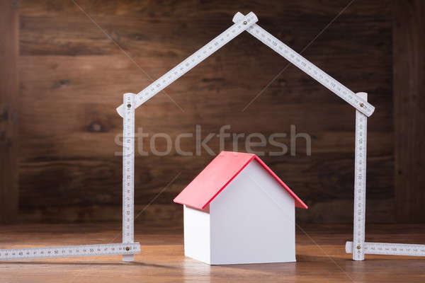 House Model Under The House Made With Measuring Tape Stock photo © AndreyPopov