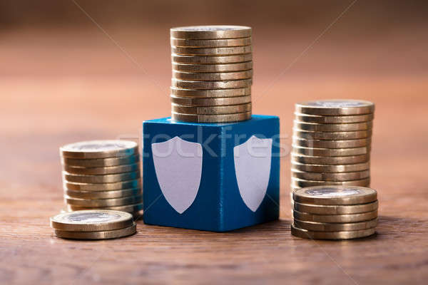 Stack Of Coins With Security Blocks Stock photo © AndreyPopov