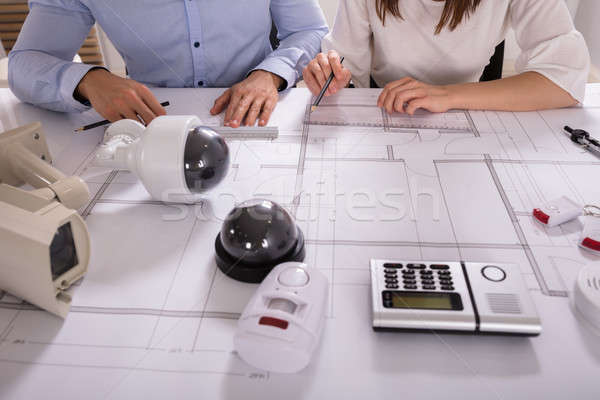 Two Architects Planning Project On Blueprint Stock photo © AndreyPopov
