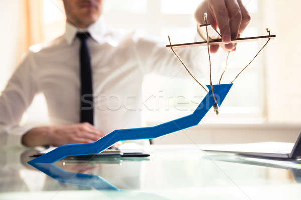 Stock photo: Businessperson Manipulating Blue Arrow