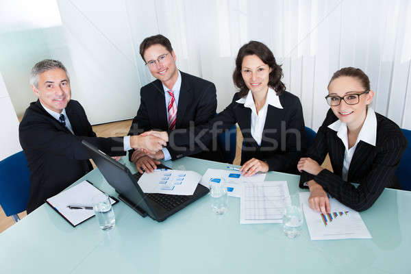 Colleagues congratulating one another Stock photo © AndreyPopov