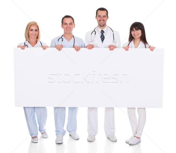 Csoport orvosok plakát boldog tart fehér Stock fotó © AndreyPopov