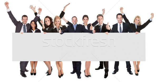 Excited business people presenting empty banner Stock photo © AndreyPopov