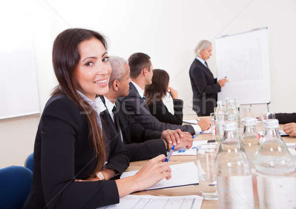 Stock photo: Young Business Woman Attending A Meeting