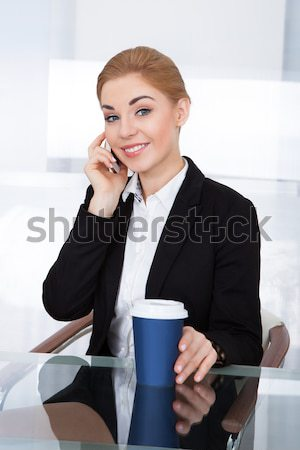 Businesswoman drinking a cup of tea Stock photo © AndreyPopov