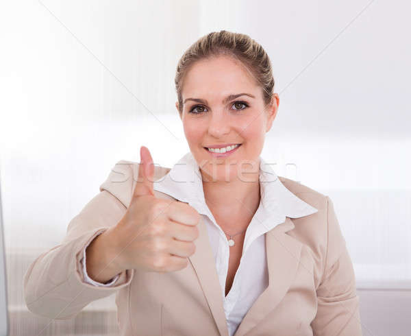 Businesswoman Showing Thumb Up Sign Stock photo © AndreyPopov