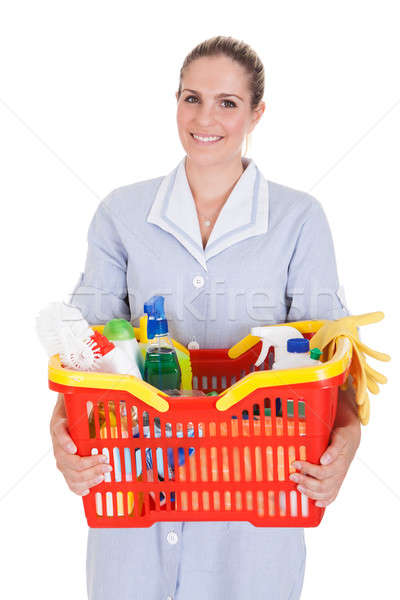 Female Cleaner Holding Chemical Supplies In Basket Stock photo © AndreyPopov