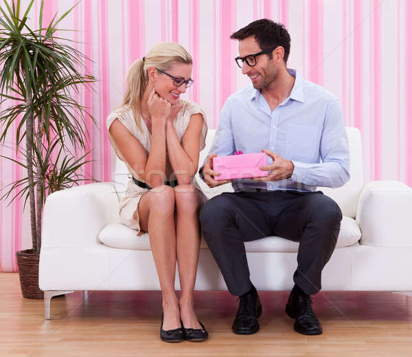Couple in love romancing on the couch Stock photo © AndreyPopov