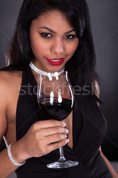 Donna vetro vino nero ragazza Foto d'archivio © AndreyPopov