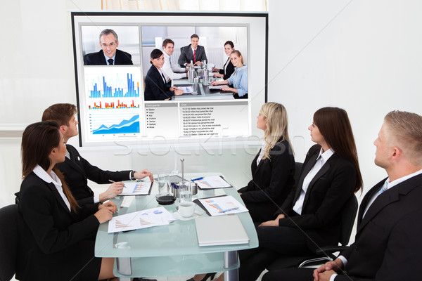 Businesspeople Looking At Projector Screen Stock photo © AndreyPopov
