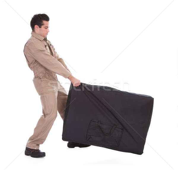 Male Worker Pulling Luggage Stock photo © AndreyPopov