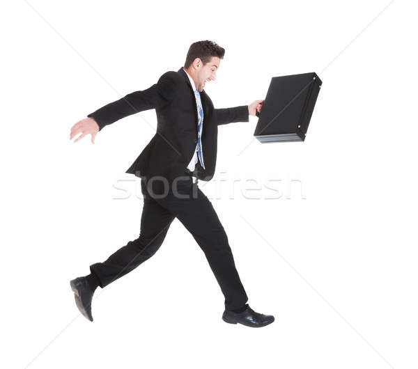 Businessman With Suitcase Running Over White Background Stock photo © AndreyPopov