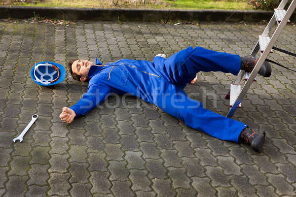 Unconscious Technician Fell From Ladder On Street Stock photo © AndreyPopov