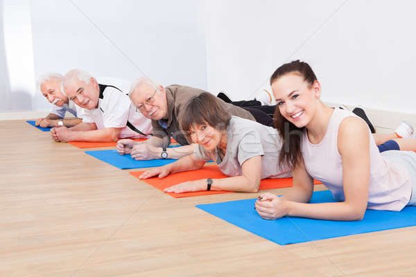 Trainer And Senior Customers At Gym Stock photo © AndreyPopov