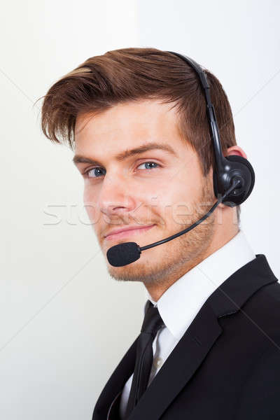 Call Center Representative Wearing Headset In Office Stock photo © AndreyPopov