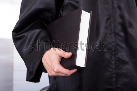 Male Judge Holding Law Book Stock photo © AndreyPopov